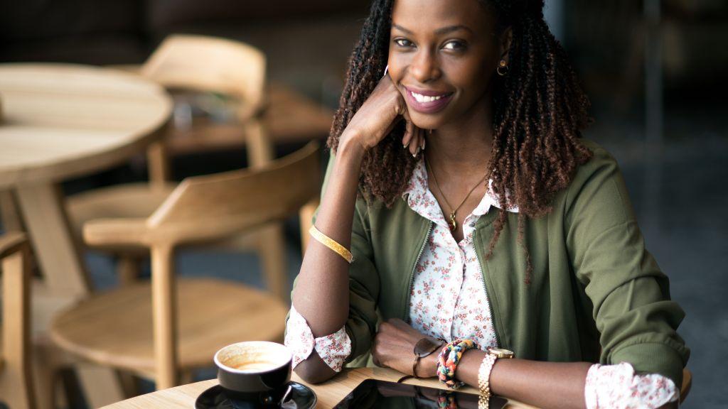 Indoor portrait of smiling African woman.