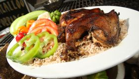March 21 2010. Jerk chicken on the grill at Uptown a Jamaican grill located at a gas station and car
