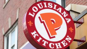Popeyes Lousiana Kitchen sing or logo outside a restaurant...