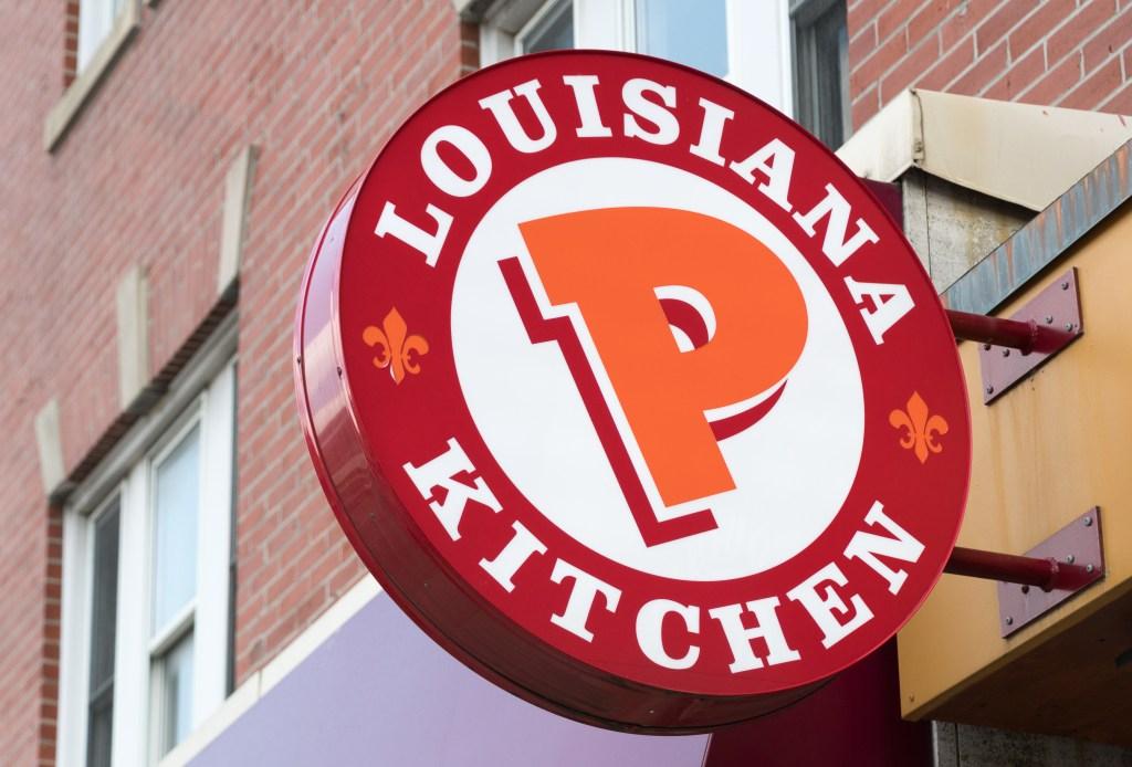 Popeyes Lousiana Kitchen sing or logo outside a restaurant...