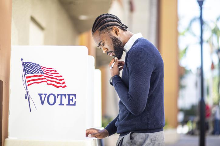 Millenial Black Man Voting in Election