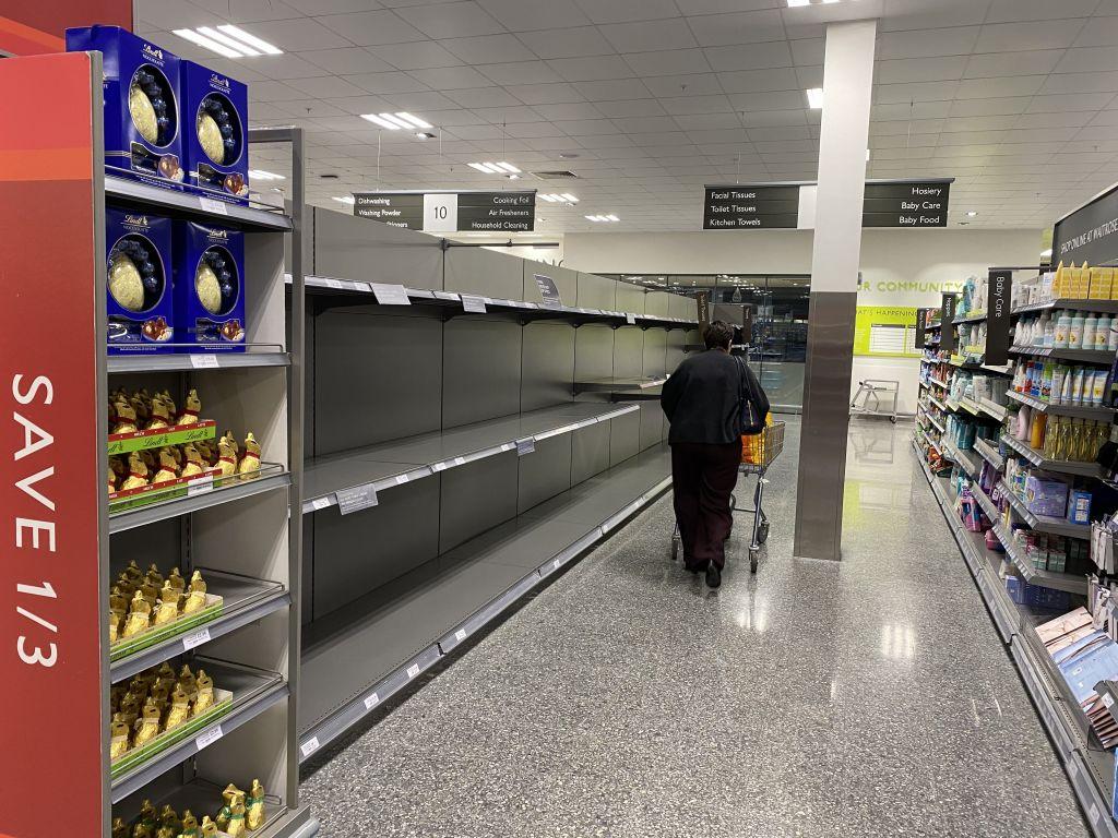 panic buyers continue to strip supermarket shelve